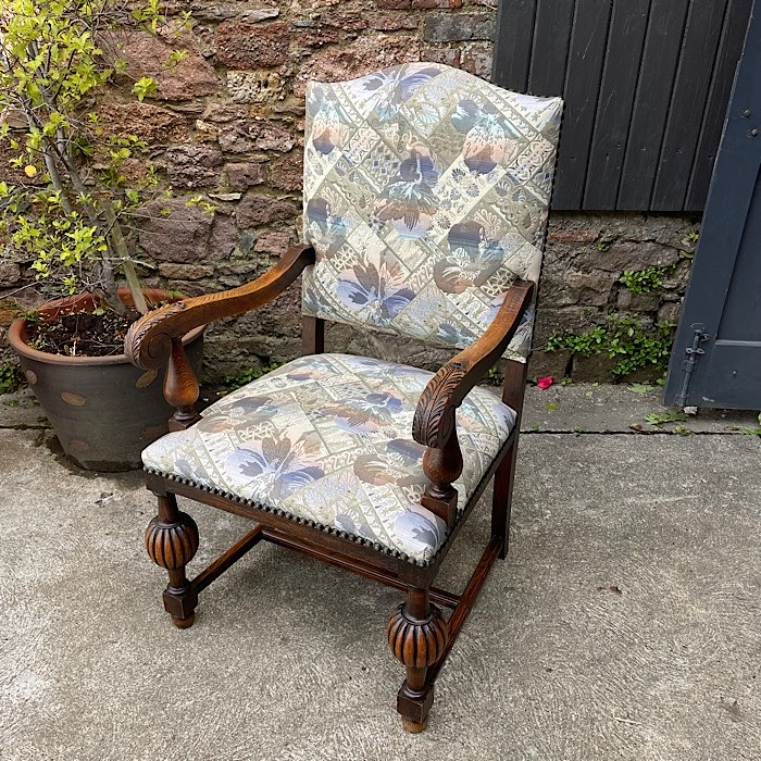 Carved Oak Continental Arm Chair