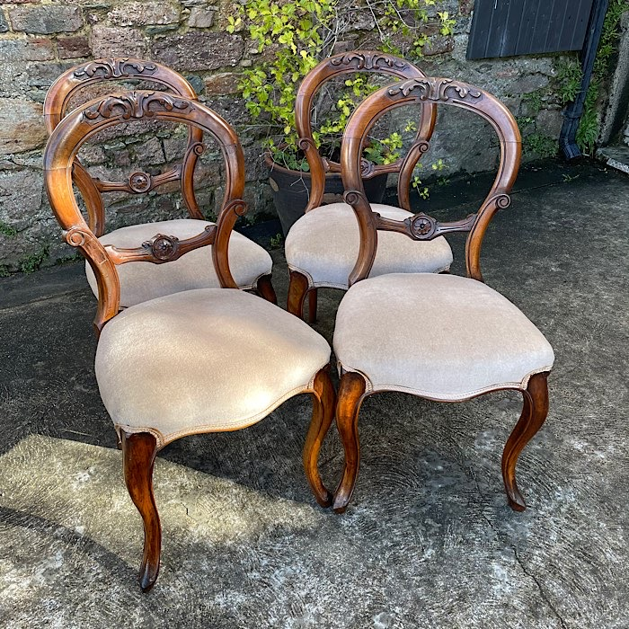Four Victorian Walnut Balloon Back Dining Chairs