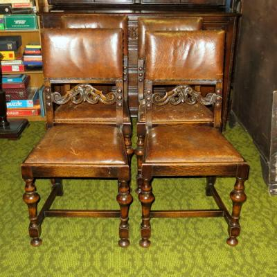Set of leather and oak dining chairs
