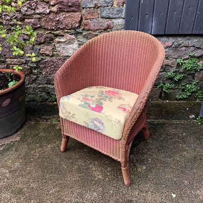 Loom Chair With Floral Cushion