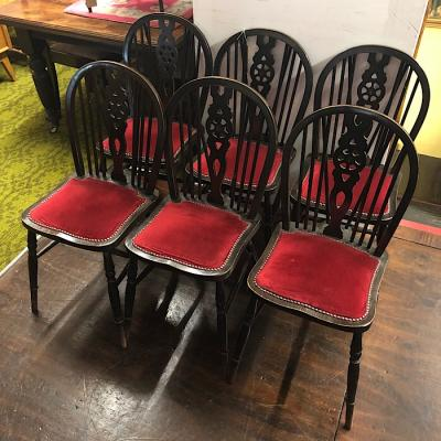 Six Upholstered Wheelback Dining Chairs