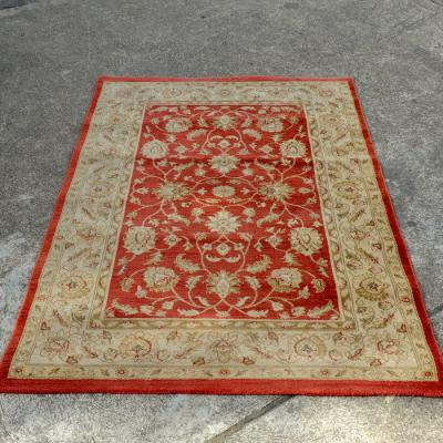 Terracotta and cream rug